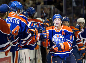 Photo - Edmonton Oilers' Taylor Hall (4) celebrates a goal with teammates against the Colorado Avalanche during first-period NHL hockey game action in Edmonton, Alberta, Thursday, Dec. 5, 2013. (AP Photo/The Canadian Press, Jason Franson)
