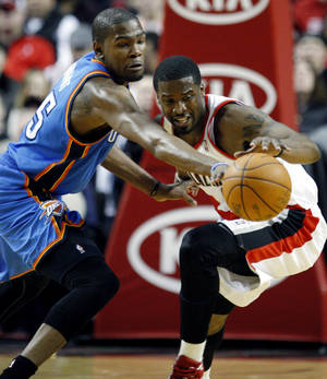 Photo - Oklahoma City Thunder's Kevin Durant, left, knocks the ball from Portland Trail Blazers' Wesley Matthews, right, in the first quarter of an NBA basketball game, Tuesday, March 27, 2012, in Portland, Ore. (AP Photo/Rick Bowmer) ORG XMIT: ORRB111