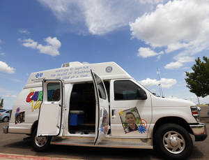 Photo - The Caring Van provides a mobile immunization clinic at John Marshall Mid-High School, Monday, July 14, 2014. Oklahoma City Public Schools is teaming with the Oklahoma Caring Foundation and the Oklahoma City County Health Department to bring Caring Van clinics to selected schools for 10 days. Photo by Nate Billings, The Oklahoman