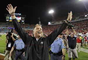 Photo -   Georgia head coach Mark Richt celebrates after their 17-9 win over Florida in an NCAA college football game against Georgia, Saturday, Oct. 27, 2012 in Jacksonville, Fla. (AP Photo/Stephen Morton)