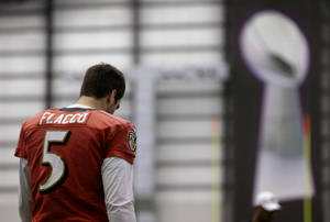 Photo - Baltimore Ravens quarterback Joe Flacco warms up during a practice at the team's practice facility in Owings Mills, Md., Wednesday, Jan. 16, 2013. The Ravens are scheduled to face the New England Patriots in the AFC Championship on Sunday. (AP Photo/Patrick Semansky)