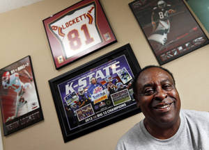 Photo - John Lockett poses for a photo with sports memorabilia from his sons and grandson at his home in Tulsa, Okla. Monday, Sept. 30, 2013. The athletic success of his sons, Kevin Lockett and Aaron Lockett, at Kansas State is being continued by Tyler Lockett, Kevin's son.  Photo by Nate Billings, The Oklahoman <strong>NATE BILLINGS - NATE BILLINGS</strong>