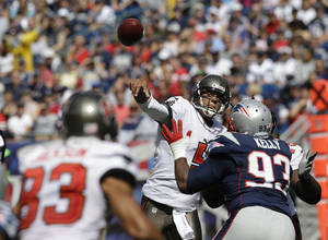 Photo - Tampa Bay Buccaneers quarterback Josh Freeman (5) passes over New England Patriots defensive tackle Tommy Kelly (93) to wide receiver Vincent Jackson (83) in the first half of an NFL football game Sunday, Sept. 22, 2013, in Foxborough, Mass. (AP Photo/Stephan Savoia)