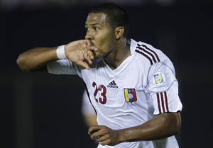 Photo -   Venezuela's Jose Rondon celebrates after scoring against Paraguay at a World Cup 2014 qualifying soccer match in Asuncion, Paraguay, Tuesday, Sept. 11, 2012. (AP Photo/Jorge Saenz)