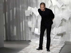 "photo - FILE - In this Sept. 9, 2011 file photo, designer Jason Wu takes a bow after presenting his Spring 2012 collection during Fashion Week in New York. Wu may have won international recognition for twice designing inaugural gowns for U.S. first lady Michelle Obama, but judges in his native Taiwan seem unimpressed. Taiwan's Intellectual Property Court ruled Monday, Jan. 21, 2013 that Wu's new label ""Miss Wu"" could not be registered as a brand because it was not distinctive enough. He designed Michelle Obama's white inaugural gown in 2008. On Monday, she appeared in another of his creations, a shiny gown with a red halter top. (AP Photo/Mary Altaffer, File)"