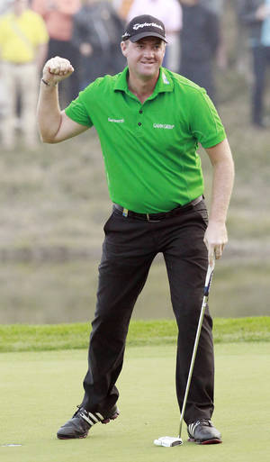 Photo -   Peter Hanson of Sweden celebrates his winning of the Masters golf tournament in Shanghai, China on Sunday Oct. 28, 2012. (AP Photo/Eugene Hoshiko)