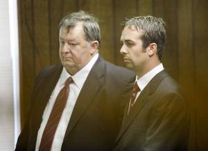 Photo - Defense attorney Carl Hughes, left and former Oklahoma Highway Patrol Trooper Patrick Venable make their initial court appearance in the Logan County Courthouse in Guthrie Tuesday. <strong>Steve Gooch - Steve Gooch</strong>