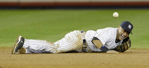 photo - New York Yankees shortstop Derek Jeter reacts after injuring himself in the 12th inning of Game 1 of the American League championship series against the Detroit Tigers early Sunday, Oct. 14, 2012, in New York.(AP Photo/Paul Sancya ) ORG XMIT: NYY210