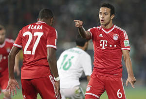 Photo - Bayern's Thiago Alcantara, right, celebrates scoring his side's 2nd goal with his teammate David Alaba during the final of the soccer Club World Cup  between FC Bayern Munich and Raja Casablanca in Marrakech, Morocco, Saturday, Dec. 21, 2013. (AP Photo/Matthias Schrader)