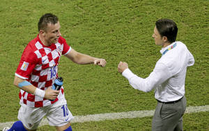 Photo - Croatia's Ivica Olic, left, is congratulated by Croatia's coach Niko Kovac after scoring the opening goal during the group A World Cup soccer match between Cameroon and Croatia at the Arena da Amazonia in Manaus, Brazil, Wednesday, June 18, 2014. (AP Photo/Fernando Llano)