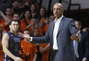Photo - TCU coach Trent Johnson gestures to an official during the first half of TCU's NCAA college basketball game against Oklahoma State in Stillwater, Okla., Wednesday, Jan. 15, 2014. (AP Photo/Sue Ogrocki)
