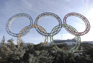 photo - Olympic rings for the 2014 Winter Olympics are installed in the Black Sea resort of Sochi, southern Russia, late Tuesday, Sept. 25, 2012.  With the Winter Olympics a year away, IOC President Jacques Rogge praised Sochi organizers on Wednesday, Feb. 6, 2013 and defended the $51 billion price tag. (AP Photo/Ignat Kozlov))