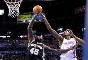 Photo - Oklahoma City Thunder's Kevin Durant (35) blocks San Antonio Spurs' DeJuan Blair shot during the NBA basketball game between the Oklahoma City Thunder and the San Antonio Spurs at the Chesapeake Energy Arena in Oklahoma City, Sunday, Jan. 8, 2012. Photo by Sarah Phipps, The Oklahoman
