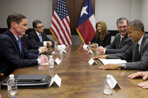 Photo - President Barack Obama, right, next to Dallas Mayor Mike Rawlings attends a meeting about the border and immigration with local elected officials and faith leaders, including Texas Gov. Rick Perry, second from left, at DalFort Fueling in Dallas, Wednesday, July 9, 2014. From left are Judge Clay Jenkins, Gov. Rick Perry, Dallas County Commissioner Elba Garcia, Mayor Rawlings, and President Obama. (AP Photo/Jacquelyn Martin)
