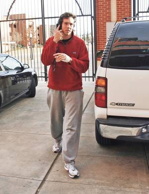photo - Oklahoma quarterback Sam Bradford arrives at the Switzer Center to see results of the BCS rankings on Sunday. Photo By Steve Sisney, The Oklahoman
