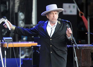 "Photo -   FILE - This July 22, 2012 file photo shows U.S. singer-songwriter Bob Dylan performing on at ""Les Vieilles Charrues"" Festival in Carhaix, western France. A staff writer for The New Yorker has resigned and his latest book has been halted after he acknowledged inventing quotes by Bob Dylan. Jonah Lehrer released a statement Monday, July 30, through his publisher, Houghton Mifflin Harcourt, that some Dylan quotes appearing in his book ""Imagine: How Creativity Works"" did ""not exist."" Others were ""unintentional misquotations, or represented improper combinations of previously existing quotes."" (AP Photo/David Vincent, file)"