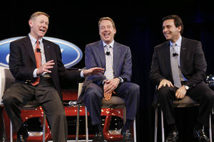 Photo - FILE - In this May 1, 2014, photo, Ford Motor Company President and CEO Alan Mulally, left, Executive Chairman Bill Ford Jr., center, and Chief Operating Officer Mark Fields speak during a news conference in Dearborn, Mich. For new Ford CEO Fields, the company's stock price hinges on the flawless production of the aluminum-body F150 pickup truck. (AP Photo/Paul Sancya)