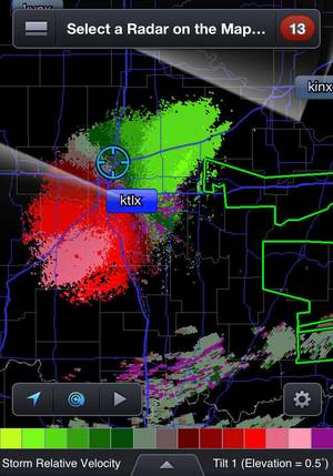Photo - The mobile application RadarScope pinpoints users' exact location and overlays it with radar and warnings, like the flood warnings highlighted in green in this screen shot. <strong></strong>