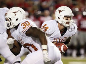 photo -   Texas fullback Ryan Roberson (30) sets up to block as quarterback David Ash (14) looks to hand off during the first quarter of an NCAA college football game against Mississippi in Oxford, Miss., Saturday, Sept. 15, 2012. (AP Photo/Rogelio V. Solis)