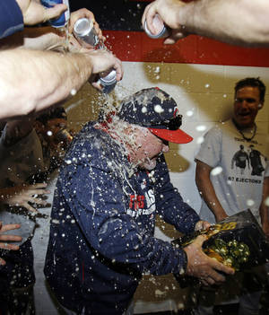 Photo - Minnesota Twins manager Ron Gardenhire is doused with beer after the Twins defeated the Cleveland Indians 7-3 in a baseball game, Saturday, April 5, 2014, in Cleveland. The Twins win gives Gardenhire his 1,000th career victory. (AP Photo/Tony Dejak)