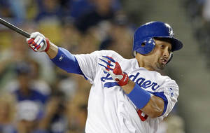 photo - FILE - In this Aug. 8, 2012, file photo, Los Angeles Dodgers' Shane Victorino follows through on a single against the Colorado Rockies in a baseball game at Dodger Stadium in Los Angeles. Victorino and the Boston Red Sox are close to completing a three-year deal worth $39 million, a person familiar with the talks told The Associated Press on Tuesday, Dec. 4, 2012. The person, speaking at the baseball winter meetings under condition of anonymity because the contract wasn't finalized, said paperwork for the contract was being completed. (AP Photo/Reed Saxon, File)