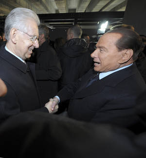 "Photo - Italian Premier Mario Monti, left, and former Premier Silvio Berlusconi shake hands in Milan, Italy, Sunday, Jan. 27, 2013. Silvio Berlusconi says Benito Mussolini did much good, except for dictator's regime's anti-Jewish laws. Berlusconi also defended Mussolini for siding with Hitler, saying the late fascist leader likely reasoned that German power would expand so it would be better for Italy to ally itself with Germany. He was speaking to reporters Sunday on the sidelines of a ceremony in Milan to commemorate the Holocaust. When Germany's Nazi regime occupied Italy during World War II, thousands from the tiny Italian Jewish community were deported to death camps. In 1938, before the war's outbreak, Mussolini's regime passed anti-Jewish laws, barring them from universities and many professions, among other bans. Berlusconi called the laws Mussolini's ""worst fault"" but insisted that in many other things, ""he did good."" (AP Photo/Antonio Calanni)"