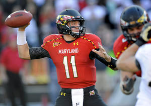 Photo -   Maryland quarterback Perry Hills (11) looks to pass during the first half of an NCAA football game against Wake Forest, Saturday, Oct. 6, 2012, in College Park, Md. (AP Photo/Nick Wass)