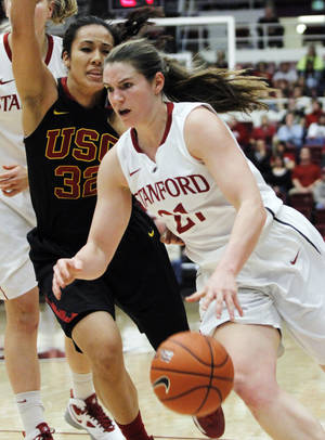 photo - Stanford's Sara James drives to the basket past Southern California's Kiki Alofaituli during the first half of an NCAA college basketball game, Sunday, Jan. 20, 2013, in Stanford, Calif. (AP Photo/George Nikitin)