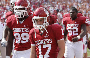 photo - Oklahoma's Jimmy Stevens (17) and his teammates walk off the field after the 45-35 loss to Texas after the college football game between the University of Oklahoma Sooners (OU) and University of Texas Longhorns (UT) in the Red River Rivalry on Saturday, Oct. 11, 2008, at the Cotton Bowl, in Dallas, Tx.   CHRIS LANDSBERGER, THE OKLAHOMAN