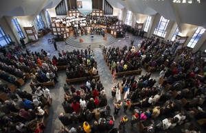 Photo - The presentation of the flags of the nations is performed before the start of the Rev. Martin Luther King Jr. holiday commemorative service at Ebenezer Baptist Church Monday, Jan. 20, 2014, in Atlanta. (AP Photo/Jason Getz)