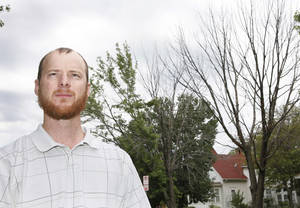 Photo - Ryan Ochsner is urban forestry coordinator in Edmond.  Photo By David McDaniel, The Oklahoman Archive