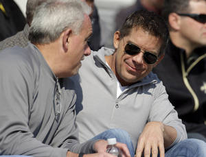 Photo - New Orleans Saints coach Sean Payton talks with assistant head coach Joe Vitt, left, during Senior Bowl football practice at Ladd-Peebles Stadium in Mobile, Ala., Wednesday, Jan. 23, 2013. The NFL reinstated Payton on Tuesday following a season long suspension. Vitt served has head coach during the suspension. (AP Photo/Dave Martin)