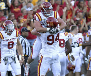 Photo -   Iowa State's Jake McDonough (94) hugs Jake Knott after Knott intercepted an Iowa pass during the fourth quarter of an NCAA college football game Saturday, Sept. 8, 2012, in Iowa City, Iowa. Iowa State won 9-6. (AP Photo/Conrad Schmidt)