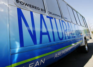 Photo - A Chesapeake bus powered by compressed natural gas. April 1, 2009. Photo by JIM BECKEL, THE OKLAHOMAN
