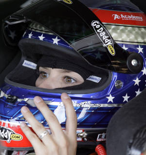Photo -   Danica Patrick checks her helmet in her car during practice for the NASCAR Sprint Cup Series auto race at Chicagoland Speedway in Joliet, Ill., Friday, Sept. 14, 2012. (AP Photo/Nam Y. Huh)