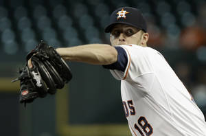 Houston Astros' Jordan Lyles winds up to pitch against the Kansas City Royals in the first inning of a baseball game on Wednesday, May 22, 2013, in Houston. (AP Photo/Pat Sullivan)