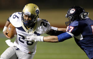 Photo - Heritage Hall's Barry Sanders fights off Cascia Hall's Conner Sherwood during the Class 3A high school football semifinal game between Heritage Hall and Cascia Hall at Pioneer Stadium in Stillwater, Okla., Friday, Dec. 2, 2011. Photo by Bryan Terry, The Oklahoman