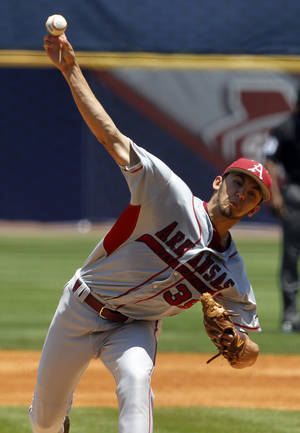 Photo - FILE - In this May 21, 2014 file photo, Arkansas' Chris Oliver (39) pitches against Mississippi during the first inning at the Southeastern Conference NCAA college baseball tournament  in Hoover, Ala. Despite an overhauled starting pitching staff this season, Arkansas _ which led the country in staff ERA a year ago _ has continued to be among the pitching leaders this season. (AP Photo/Butch Dill, File)
