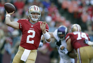 Photo - San Francisco 49ers quarterback Colt McCoy (2) passes against the Minnesota Vikings during the second quarter of an NFL preseason football game in San Francisco, Sunday, Aug. 25, 2013. The 49ers won 34-14. (AP Photo/Ben Margot)