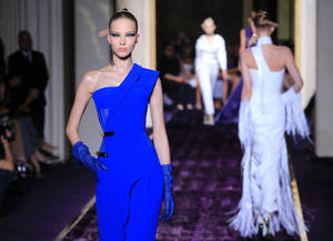 Photo - Models present creations by Italian fashion designer Donatella Versace, as part of the Atelier Versace Fall Winter 2014-15 Haute Couture fashion collection, Sunday, July 6, 2014, in Paris. (AP Photo/Jacques Brinon)
