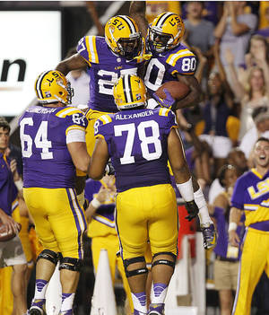 Photo -   LSU wide receiver Jarvis Landry (80) celebrates his touchdown reception with running back Kenny Hilliard (27) in the first half of their NCAA college football game against Idaho in Baton Rouge, Saturday, Sept. 15, 2012. (AP Photo/Gerald Herbert)