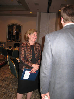 Photo - Esther George, president of the Kansas City Federal Reserve Bank, speaks with attendees during a Tulsa appearance in April 2012. Archive Photo by Don Mecoy, The Oklahoman <strong></strong>
