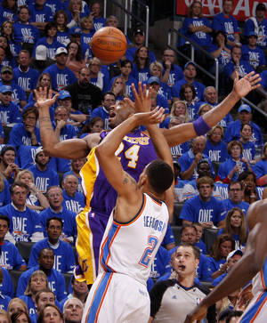 photo - Oklahoma City's Thabo Sefolosha (2) defends Los Angeles' Kobe Bryant (24) during Game 1 in the second round of the NBA playoffs between the Oklahoma City Thunder and L.A. Lakers at Chesapeake Energy Arena in Oklahoma City, Monday, May 14, 2012. Photo by Bryan Terry, The Oklahoman