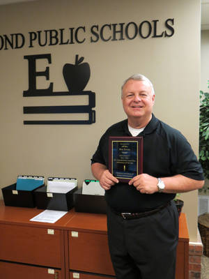 Photo -  Bret Towne, Edmond Public Schools' associate superintendent of general administration, was recognized as the Region 7 assistant superintendent/central office administrator of the year by the Oklahoma Association of School Administrators. PHOTO PROVIDED  <strong></strong>