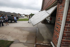 Photo - This home at 550 W. Geronimo Courtway in Mustang was damaged by a small tornado which touched down early Saturday. <strong>PAUL HELLSTERN - Oklahoman</strong>