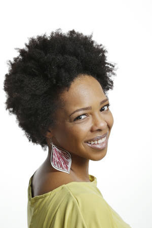 Photo - Kizzie Ledbetter wears her hair in a nautral Afro. Photo by Doug Hoke, The Oklahoman. <strong>DOUG HOKE</strong>