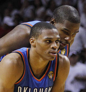 photo -   FILE - In this June 21, 2012, file photo, Oklahoma City Thunder point guard Russell Westbrook, left, and small forward Kevin Durant talk during a break in play against the Miami Heat during the second half at Game 5 of the NBA finals basketball series in Miami. General manager Sam Presti says he's confident that Durant and Westbrook are ready to evolve into better leaders even if they aren't veterans yet. (AP Photo/Lynne Sladky, File)