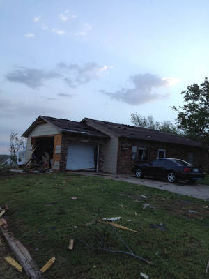 Photo -  Tornado damage to the Woodward home of Sterling Parks, one of three plaintiffs who was awarded more than $5 million in a recent case against Farmers and Foremost insurance companies. Photo provided.     <strong></strong>