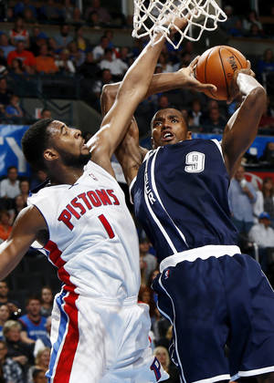 photo - Oklahoma City's Serge Ibaka (9) takes the ball to the hoop against Detroit's Andre Drummond (1) during an NBA basketball game between the Detroit Pistons and the Oklahoma City Thunder at the Chesapeake Energy Arena in Oklahoma City, Friday, Nov. 9, 2012. Oklahoma City won, 105-94. Photo by Nate Billings, The Oklahoman