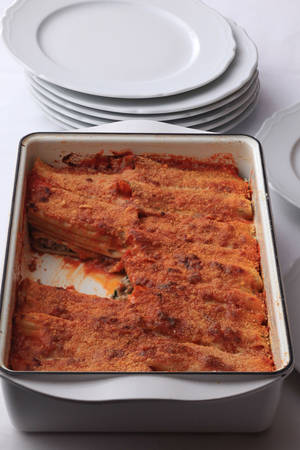 photo - When making a baked pasta, such as this Manicotti Baresi al Forno, it is important to undercook the pasta in water so that it will finish cooking in the baking process. MCT PHOTO